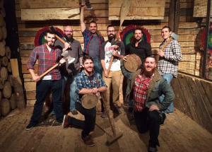 Bearded men holding axes, axe throwing, Nova Scotia Vacation, kids activities, winter season