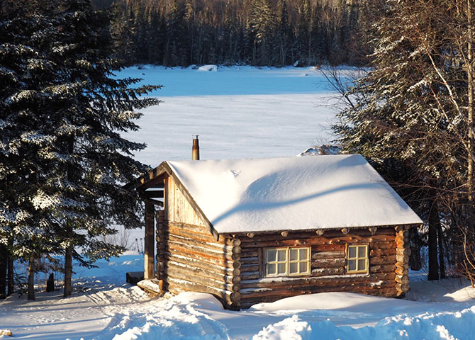 "The log cabin of ""Ti-Vieux""."