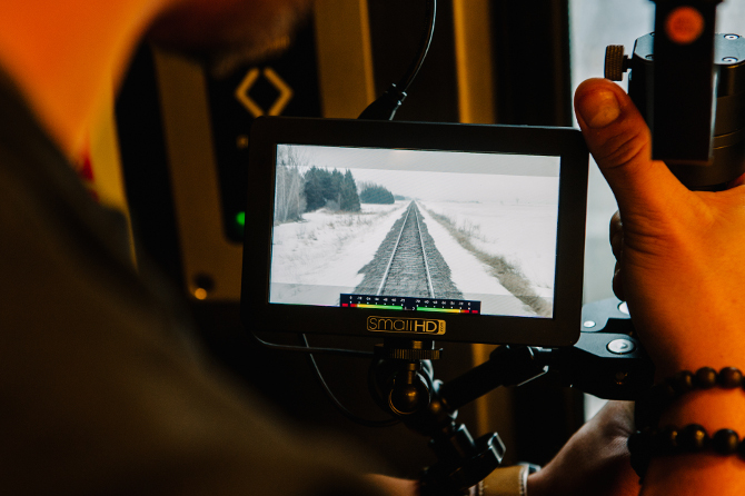 Filming the train tracks on board