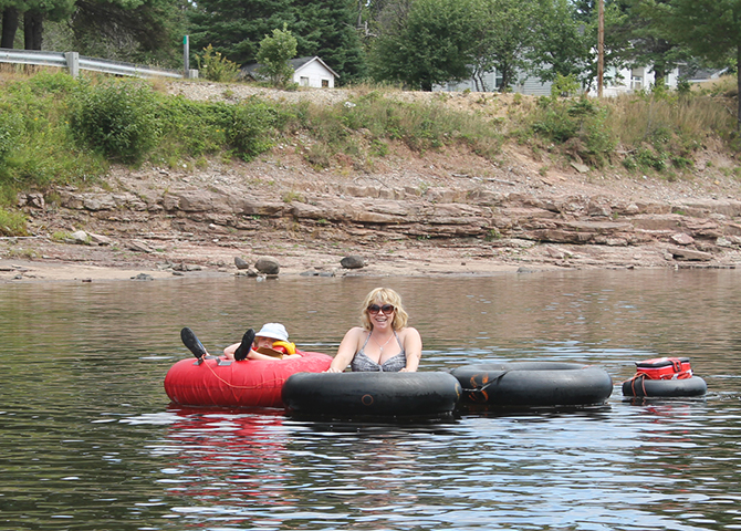 The author and her daughter tubing on the Miramichi River